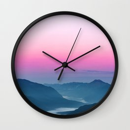 River of fog flowing through mountains at sunrise Wall Clock