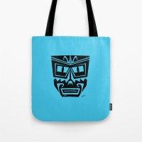 tiki Tote Bags featuring Tiki by Nick Salmon