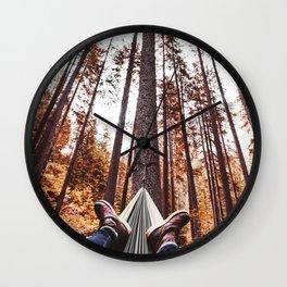man resting on the hammock Wall Clock