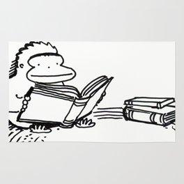 Ape on a Rug Enjoys a Book Rug