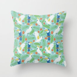 Blue toucan with white cockatoo amoung tropical flowers and leaves Throw Pillow