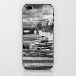 Black and White of Rusted International Harvester Pickup Truck behind wooden fence with Red Barn in iPhone Skin