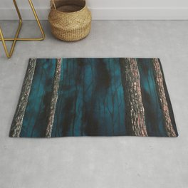 Inside the dark forest Rug