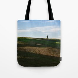 Lone tree over hills Tote Bag