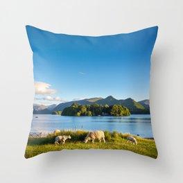 Sheep grazing on the lush shores of Lake Derwentwater, England Throw Pillow