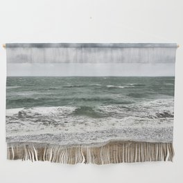 Land and sea under stormy clouds Wall Hanging