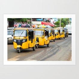 Line of yellows Tuk-Tuks in a row in Madagascar. Art Print