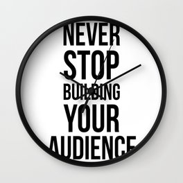 Never Stop Building Your Audience Black and White Wall Clock