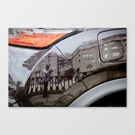 The reflection in the car Canvas Print