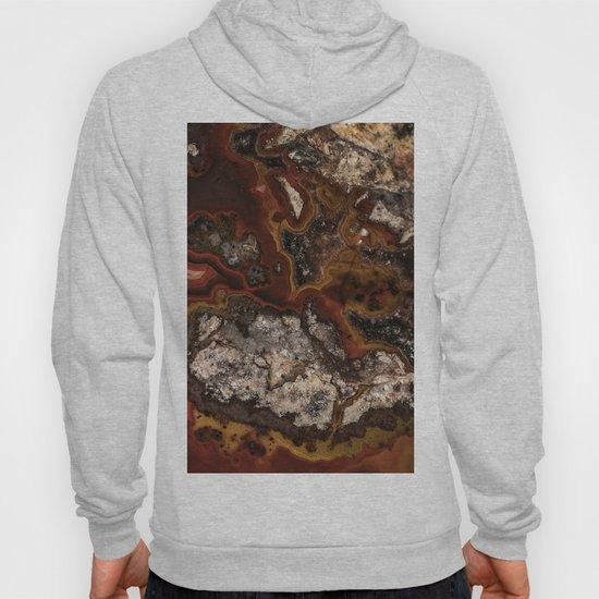Twisted patterns of brown, red and beige stone by jaroslawblaminsky