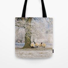 Sheep gathered under a tree covered in a thick hoar frost. Norfolk, UK. Tote Bag
