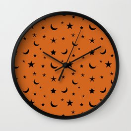 Black moon and star pattern on orange background Wall Clock