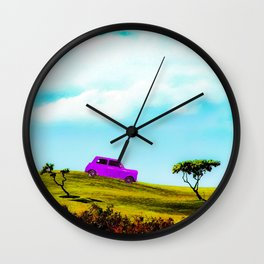 pink classic car on the green mountain with cloudy blue sky Wall Clock