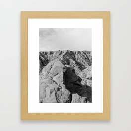 Face in the rocks Framed Art Print