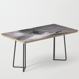 Surfer riding a wave Coffee Table