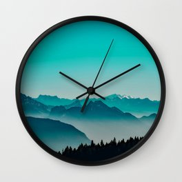 Rise above the mist. Turquoise Wall Clock