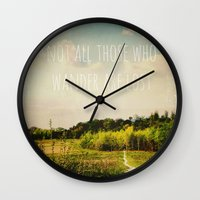 not all those who wander are lost Wall Clocks featuring not all those who wander are lost by Sybille Sterk