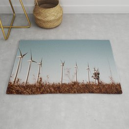Wind turbine in the desert with blue sky at Kern County California USA Rug
