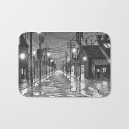 Raining on industrial street Bath Mat