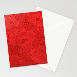 Closeup of fine elegant red lace texture with seamless floral pattern on red fabric background Stationery Cards