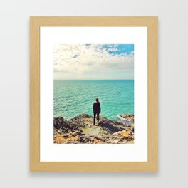 Girl looking out to sea Framed Art Print