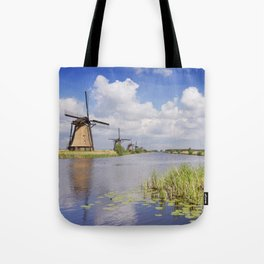 Traditional Dutch windmills on a sunny day at the Kinderdijk Tote Bag