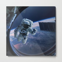 Astronaut in outer space through the porthole Metal Print