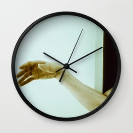 reaching out. Wall Clock