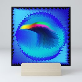 The emblem of an eagle bird head in motion blur. Medal with the image of an eagle on a blue backgrou Mini Art Print
