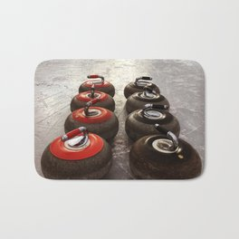 Curling on the lake Bath Mat