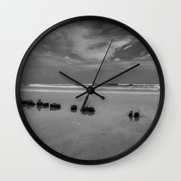 Exposed driftwood structure on Assateague Island (black and white) Wall Clock