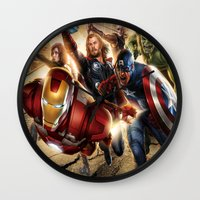 avenger Wall Clocks featuring The Avenger by Tania Joy