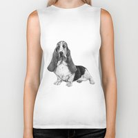 the hound Biker Tanks featuring Basset Hound by Danguole Serstinskaja
