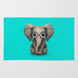 Cute Baby Elephant Calf with Reading Glasses on Blue Rug