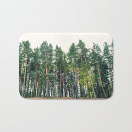 Pine forest against a white sky Bath Mat