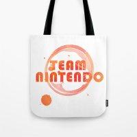 nintendo Tote Bags featuring Team Nintendo by Bradley Bailey