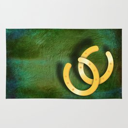 Lucky horseshoes on a textured green background Rug