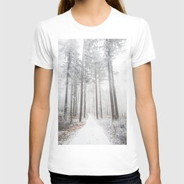 Mysterious road in a frozen foggy forest T-shirt