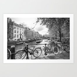 Bicycles parked on bridge over Amsterdam canal Art Print
