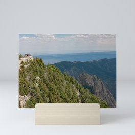 Stone ruins of Kiwanis Cabin on a distant peak on the Sandia Crest in the Sandia Mountains outside of Albuquerque, New Mexico Mini Art Print