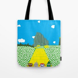 Pengwins that are following a brick road that is yellow Tote Bag