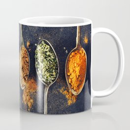 Colorful spices in metal spoons Coffee Mug