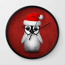 Baby Penguin Wearing a Santa Hat on Red Wall Clock