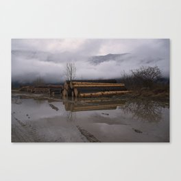 Timber Logs With A Foggy Mountain View Canvas Print