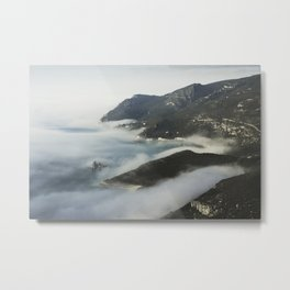 Misty ocean by the mountains Metal Print