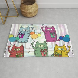 Funny colorful cats with gifts and inflatable balls in their paws Rug