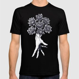 Hand with lotuses on black T-shirt