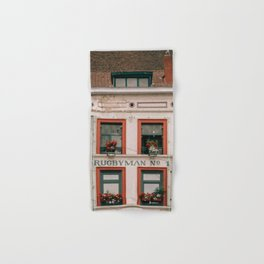 Cute building with red window frames Hand & Bath Towel