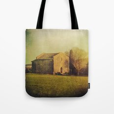 A cute small stone house without windows Tote Bag
