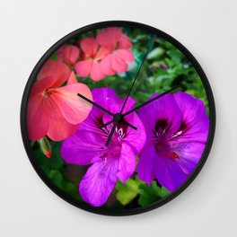Pink geraniums and purple flowers Wall Clock